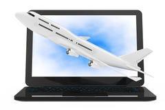 Ordinateur portable moderne avec l'avion blanc Flyin du ` s de Jet Passenger Images stock