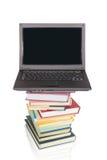 Ordinateur portable sur des livres, collage Images stock