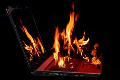 ordinateur portatif brûlant Photos libres de droits