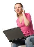 ordinateur portatif d'écouteur de fille Image stock