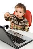 ordinateur portatif de chéri utilisant Photographie stock libre de droits