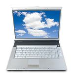 Ordinateur portatif de ciel bleu Photographie stock libre de droits