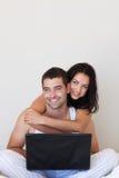 ordinateur portatif de couples ensemble utilisant Photo libre de droits
