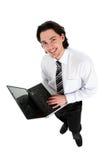 Ordinateur portatif de fixation d'homme d'affaires Photo stock