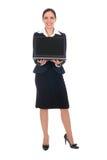Ordinateur portatif de fixation de femme d'affaires Image libre de droits