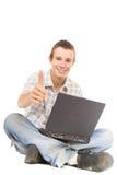 ordinateur portatif de l'adolescence Images libres de droits