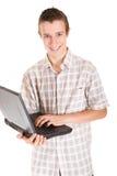 ordinateur portatif de l'adolescence Photos libres de droits