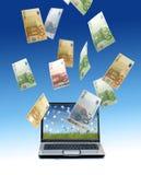 Ordinateur portatif et euro argent. photographie stock