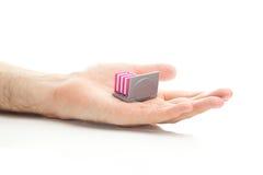 Ordinateur portatif et livres miniatures Images stock