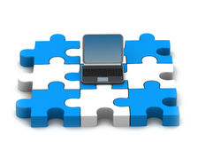 Ordinateur portatif et puzzle Photos stock