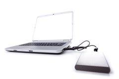 Ordinateur portatif et un disque externe Image stock