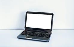 Ordinateur portatif sur la table Images stock