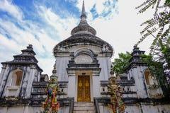 Ordination hall with Blue sky and Giant guard at Wat Pra Ngam, Ayutthaya stock image
