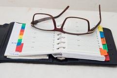 Ordine del giorno e vetri Fotografia Stock