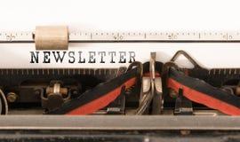 OrdINFORMATIONSBLAD som är skriftligt på tappningskrivmaskinen arkivfoton
