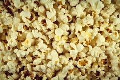 Ordnar till rimmade vita för popcorn På alla foto wallpaper arkivfoto