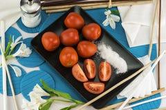 Ordning av den röda tomaten Arkivfoto