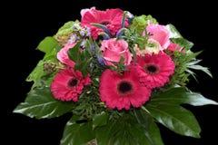 Ordning av rosa blommor Royaltyfria Bilder