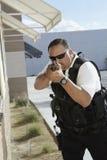 Ordningsvakt Aiming With Gun Royaltyfria Foton