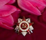 Ordnung des patriotischen Bezirks und der Blume. Stockbild
