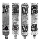 OrdNYHETERNA i gamla skrivmaskinsTypebarbokstäver som isoleras på vit royaltyfri fotografi