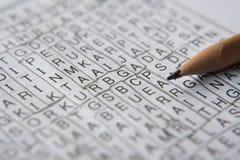 Ordpusselsvårt problem med blyertspennan royaltyfri foto