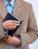 Ordre du jour de fixation d'homme d'affaires. Photo libre de droits