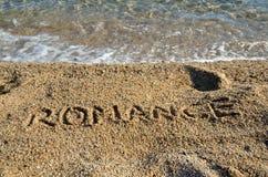 Ordromans på stranden Arkivfoto