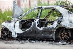 Ordure de véhicule de voiture de roue brûlée par feu d'incendie criminel Photo libre de droits