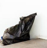 ordures noires de sac Photos stock