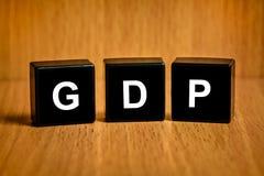 Ordynarny produkt krajowy lub GDP słowo na czerń bloku obrazy royalty free