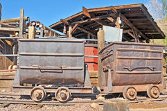Ore Carts. These two metal ore carts were used to transport silver bearing ore out of the mines of Calico. they were pulled by a small steam powered locomotive royalty free stock images
