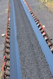 Ore on conveyor Stock Image