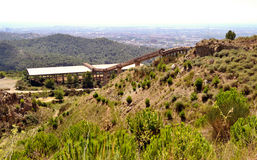 Ore conveyor. Old conveying of minerals in an abandoned quarry in Collserola, Barcelona Stock Images