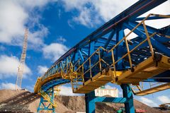 Ore conveyor in open pit mining stock images
