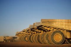 Ore hauling trucks in row Telfer Western Australia Stock Image