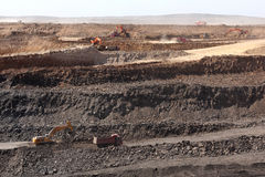 Ore mining in the open pit. Trucks carry ore open pit Stock Images