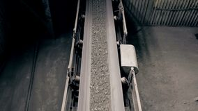 Ore move on conveyor in modern processing plant stock footage