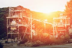 The ore processing plant or factory at the mining quarry in the sunset. Industrial background royalty free stock images
