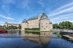 Orebro castle reflecting in water, Sweden stock images