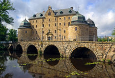 Orebro castle, Sweden. Medieval stone castle surrounded by a moat stock images