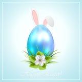 Orecchie blu dell'uovo di Pasqua e del coniglietto Fotografie Stock