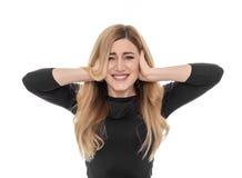 Orecchie di chiusura della donna bionda con le dita Fotografia Stock