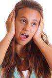 Orecchie teenager della holding Immagine Stock
