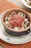Orecchiette pasta with tomato sauce Stock Photo