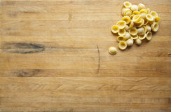 Orecchiette Sitting on a Worn Cutting Board Royalty Free Stock Photo