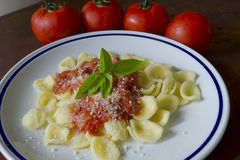 Orecchiette and tomatoes Stock Images