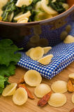 Orecchiette with turnip tops. Stock Image