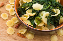 Orecchiette with turnip tops. Stock Photo