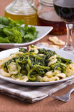 Orecchiette with turnip tops. Royalty Free Stock Photo